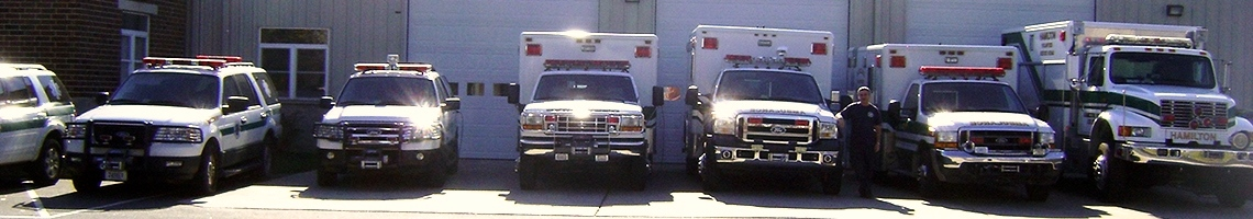 Banner: All HVRS vehicles lined up in front of the building