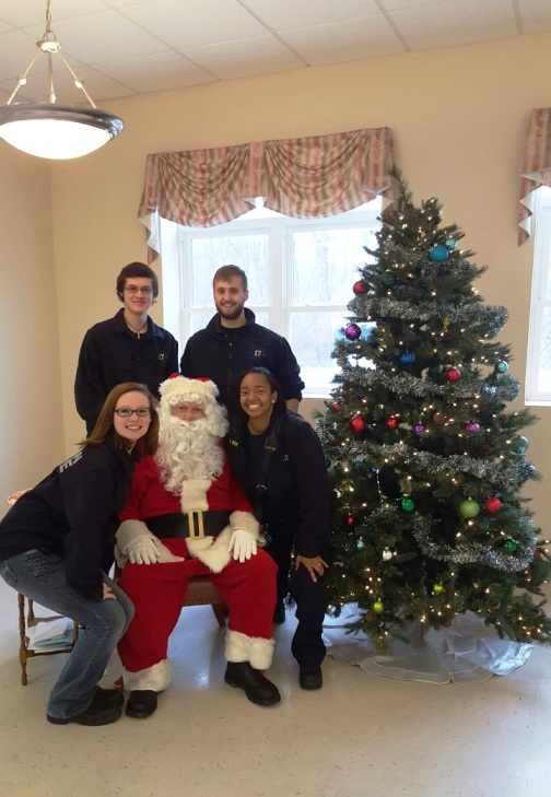 Members of Co. 17 around Santa