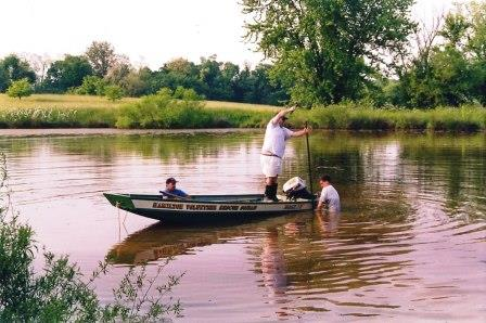 Old photo of Co. 17's boat on a pond