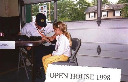 A volunteer taking a child's blood pressure at the Open House 1998