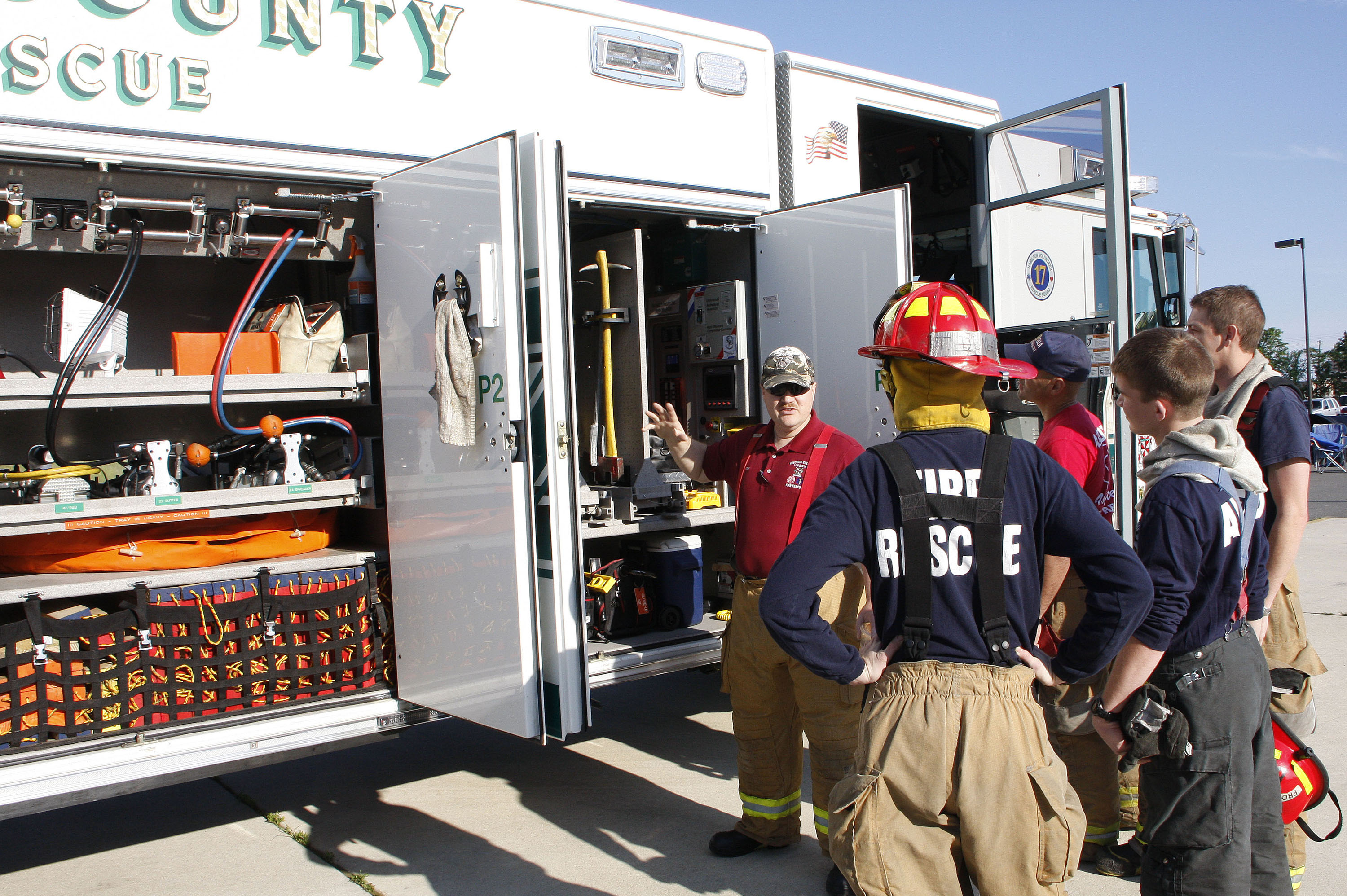 An instructor teaching other volunteers about the squad truck equipment