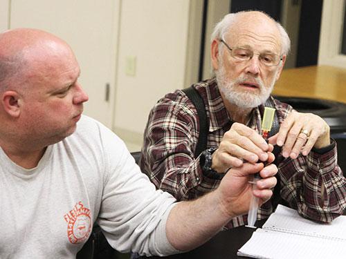 Two volunteers looking at IV supplies.