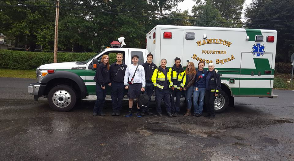 Group of volunteers beside an ambulance