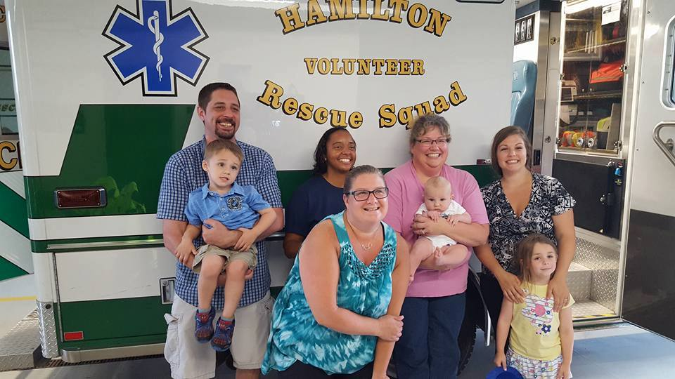 Volunteers of Company 17 with baby Wesley